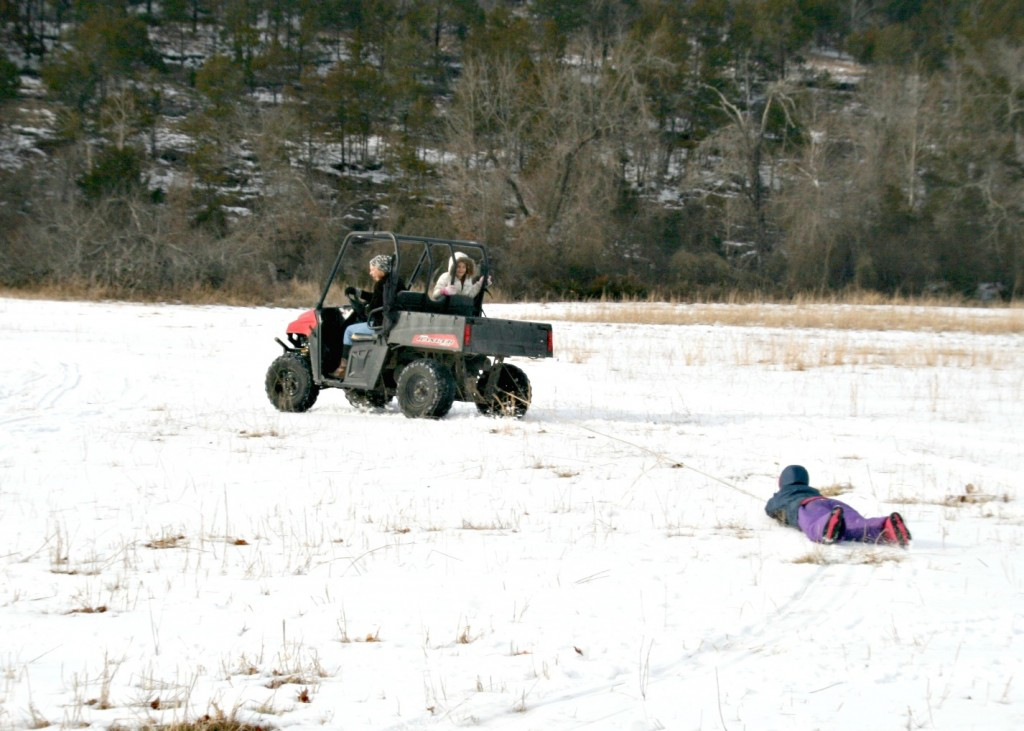 This is one of our favourite winter sports! Someone drives the Polaris, and then the rest of us take turns getting tossed to and fro on some sort of smooth surface. This year we chose a trash bag.