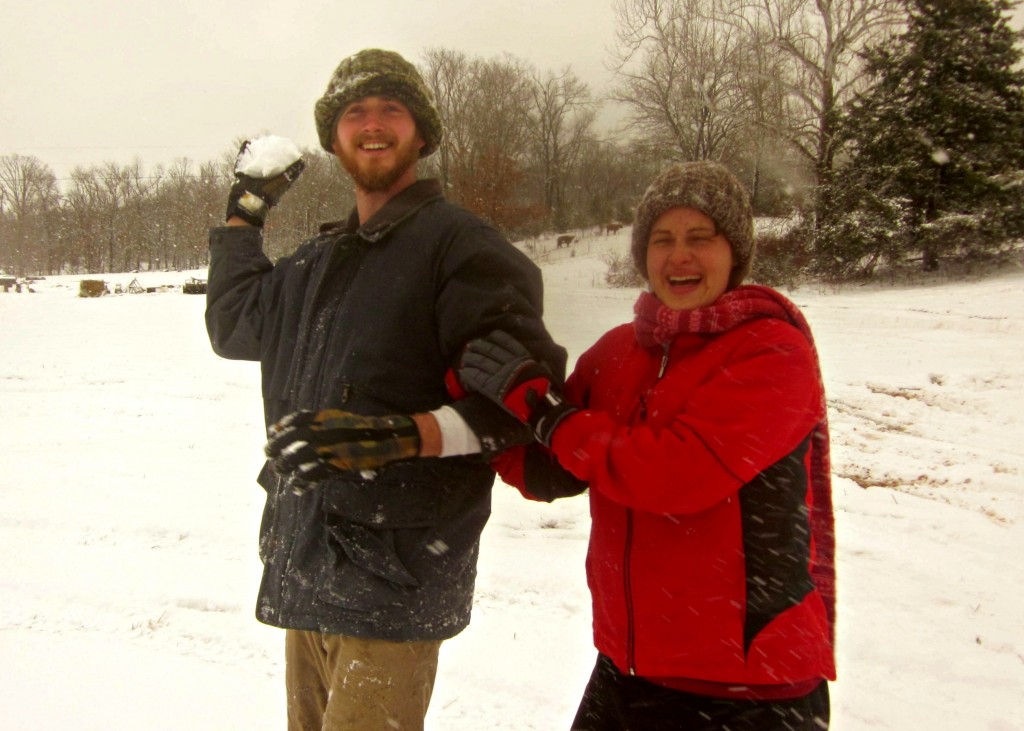 By the look on Sarah's face, I'm figuring somebody's on the other side of the camera about to launch a snowball!