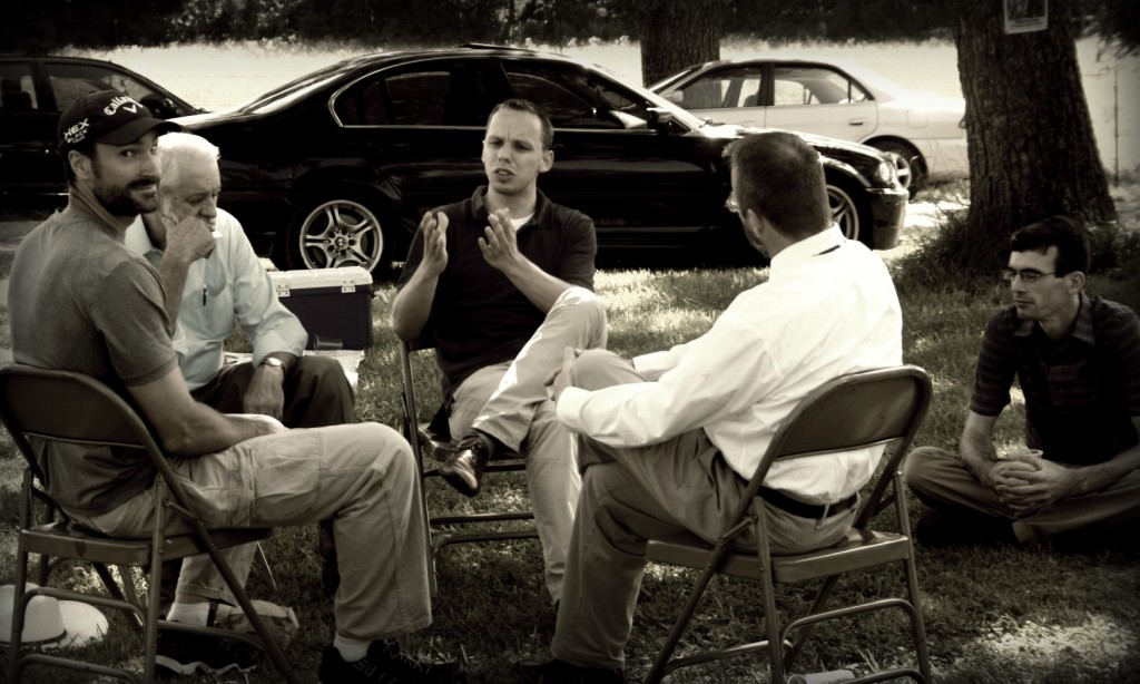 The Pastors gather and talk.